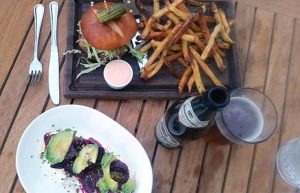 Copper Kitchen Happy Hour CK Burger with Parmesan Fries and Beet & Avocado Salad