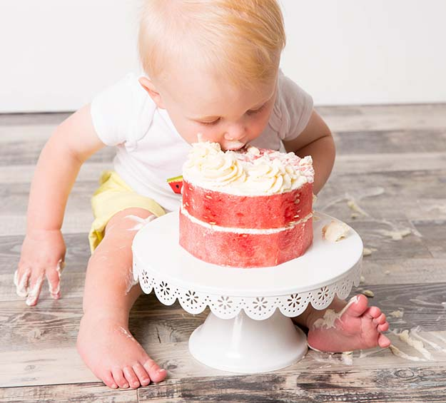One in a Melon First Birthday Party Birthday Boy digging into the watermelon cake