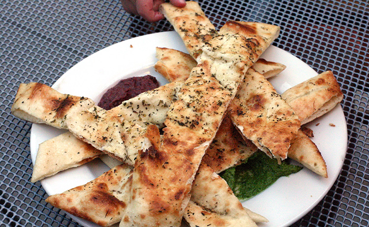 Cafe Trio Restaurant hidden kid-friendly spot Flatbread and incoming toddler hand